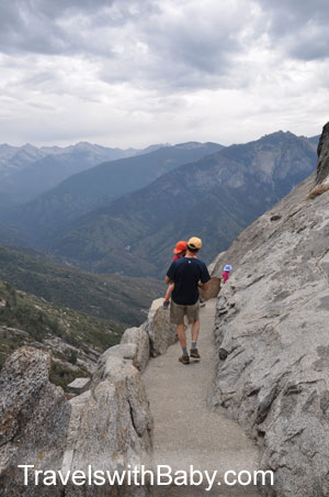 Toddler carried by dad on Moro Rock Trail