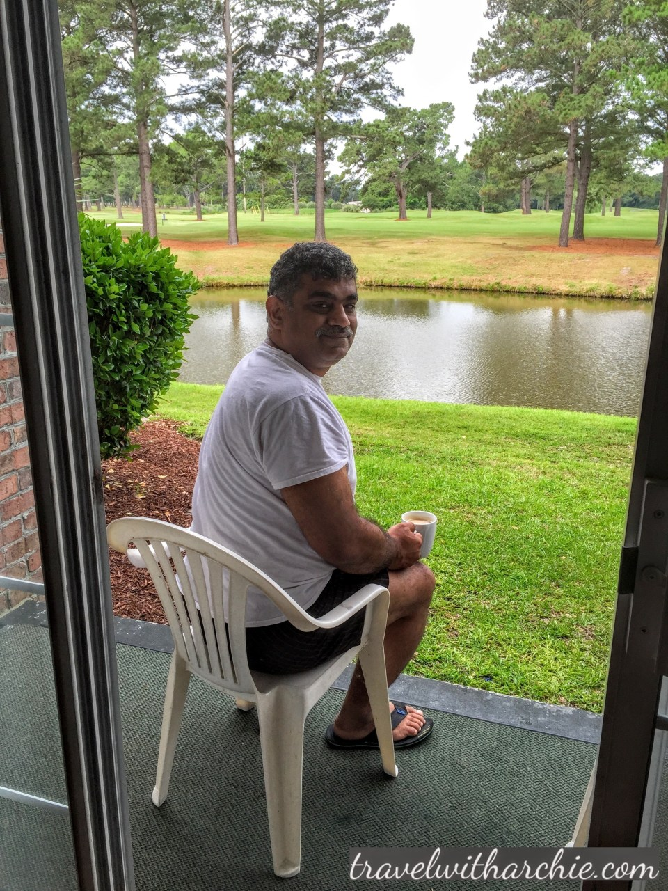 My husband Desh with his morning tea right outside our the infamous 'french doors' :-)