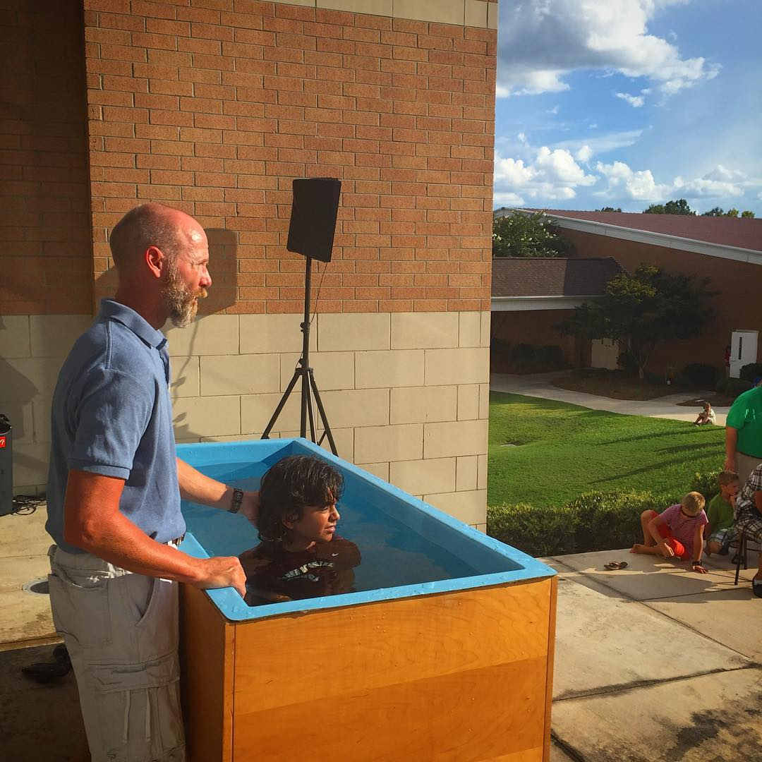 Father, uncles, and pastors baptizing new members of the family. Love these moments!