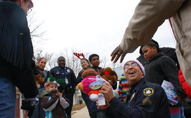 Kids Cicle Around James City Police Officers And Other
