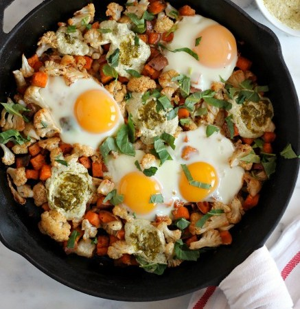 Sweet Potato Cauliflower Egg Skillet with Yogurt Pesto // treatswithatwist.com