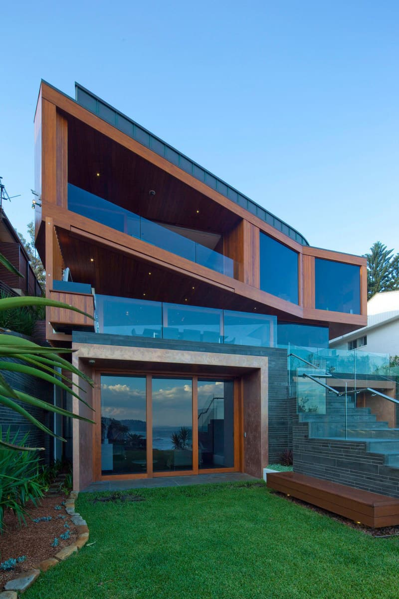 Resort house with angled terraces of wood and glass