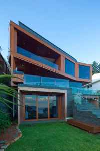 Resort house with angled terraces of wood and glass ...