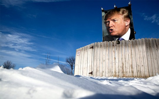 Snow blankets the ground around a picture of U.S. Republican presidential candidate Donald Trump displayed outside
