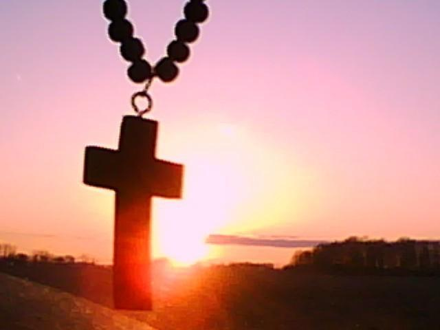 cross pendant in the sunset