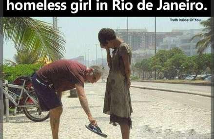 A man giving his shoes to a homeless girl in Rio de Janeiro.