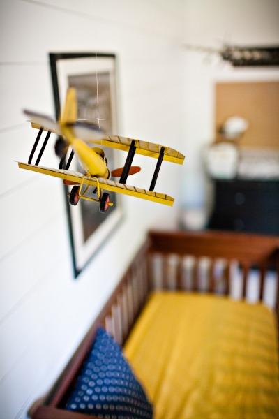 nursery plane tucking in superheroes.com.jpg