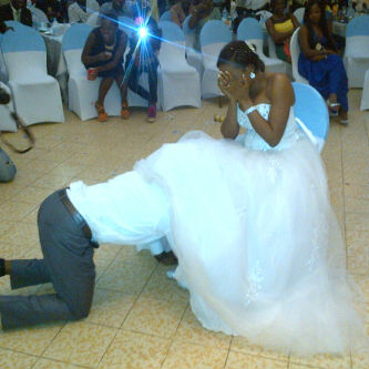 Photo: What Is The Groom Doing To The Bride?