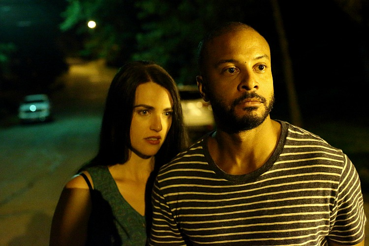 Sarah (Katie McGrath) and Dylan (Brandon Jay McLaren) face off against some local teens