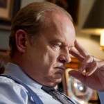 Kane (Kelsey Grammer) gives Ian (Jonathan Groff) and errand to run