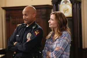 "PLAYING HOUSE -- ""An Officer and a Gentleman"" Episode 207 -- Pictured: (l-r) Keegan-Michael Key as Mark Rodriguez, Lennon Parham as Maggie Caruso -- (Photo by: Michael Yarish/USA Network)"