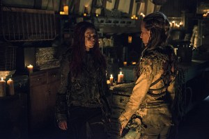 "The 100 -- ""Wanheda: Part One""  -- Image HU301b_0186 -- Pictured (L-R): Eliza Taylor as Clarke and Jessica Harmon as Niylah -- Credit: Cate Cameron/The CW -- © 2015 The CW Network, LLC. All Rights Reserved"