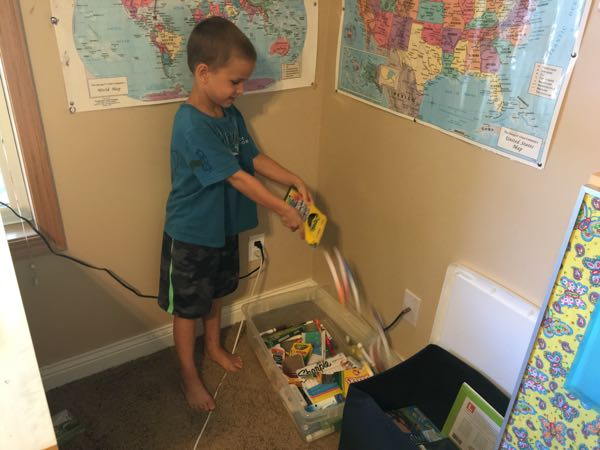 Child dumping school supplies