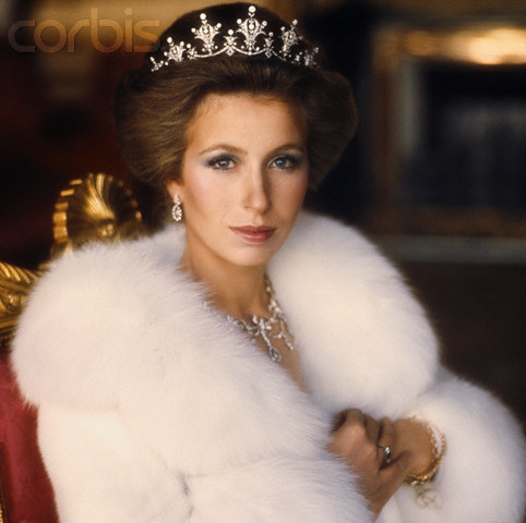 ca. November 1973, UK --- Her Royal Highness Princess Royal Anne wears a white fur coat and crown for a Vogue photo shoot. --- Image by © Norman Parkinson/Sygma/Corbis