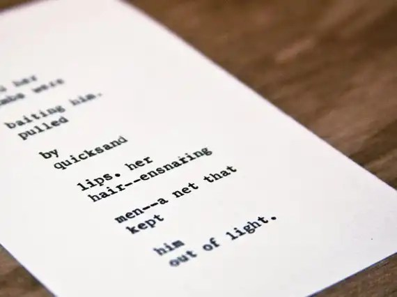 """Etsy typewriter poetry poem on wooden card stock background. """"Adam"""" by billimarie, on sale at the Typewriter Poetry Etsy shop. Dutch angle shot, in color."""