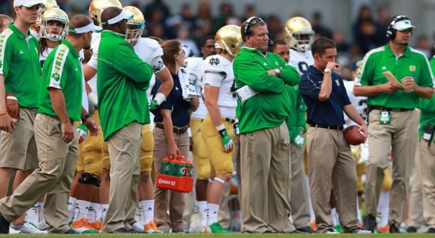 Dublin, Ireland. Notre Dame Fighting Irish head coach Brian Kelly and his staff watch on during the American Football game between Notre Dame and Navy from the Aviva Stadium. (Paul Walsh/Actionplus/Icon SMI)