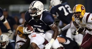 Delray Beach, Florida, U.S. - LAKE WORTH, FL . Glades Central vs American Heritage. American Heritage running back #4 Greg Bryant runs up the middle as Glades Centrals #31 Willie Floyd chases.  (Photo - Zuma Press / Icon SMI)