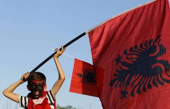 A boy with his face painted in the colours of the Albanian flag, waves Albanian flags during a protest in Skopje, Macedonia, Saturday, June 13, 2015  Read more here: http://www.charlotteobserver.com/news/nation-world/article24050035.html#storylink=cpy