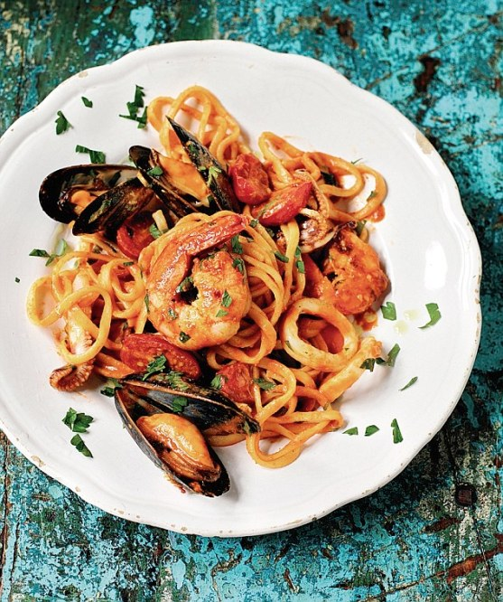 Serves 4 60ml (2¼fl oz) olive oil 2 cloves of garlic, crushed, not peeled 12 medium raw prawns, peeled, shells and heads reserved 2tbsp tomato paste 300ml (10fl oz) water 350g (12oz) dried linguine Salt 60g (2¼oz) squid rings and tentacles 16 mussels, in the shell, scrubbed ¼tsp chilli flakes 2 handfuls of cherry tomatoes, halved 10 grinds of black pepper A handful of flat-leaf parsley, roughly chopped   Read more: http://www.dailymail.co.uk/femail/food/article-3173601/Rick-s-Mediterranean-marvels-Seafood-linguine-Albania.html#ixzz3gw9OSkw5  Follow us: @MailOnline on Twitter | DailyMail on Facebook