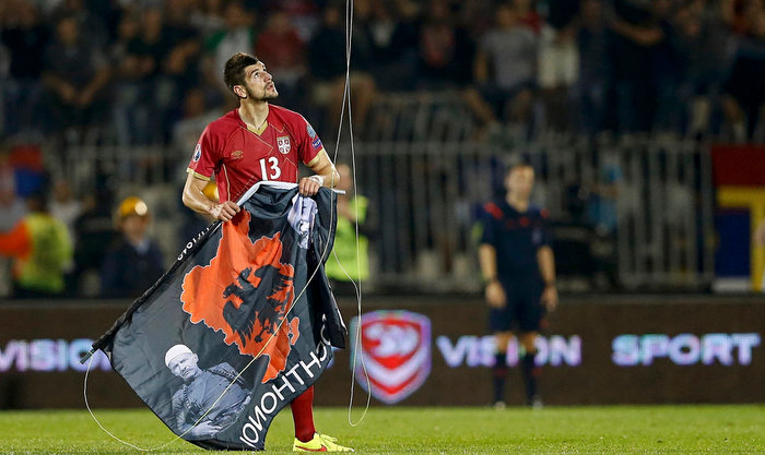 Stefan Mitrovic of Serbia grabs a flag bearing an insignia of 'Greater Albania' which was flown over the stadium during the Euro 2016 qualifier last year. Photograph: Marko Djurica/Reuters