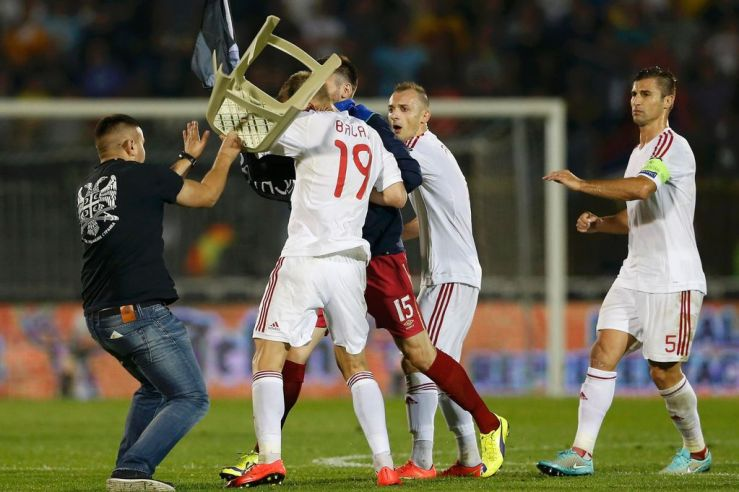An Albanian footballer attacked by a Serbian ultra-nationalist on the pitch during the Serbia-Albania football match, 14 October 2014