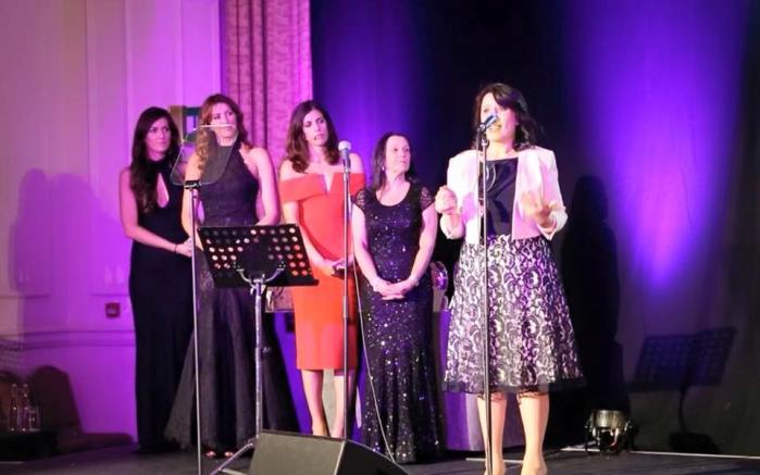 """Mirela Sula delivering a speech after accepting the award from """"Inspiration Awards For Women 2015"""""""