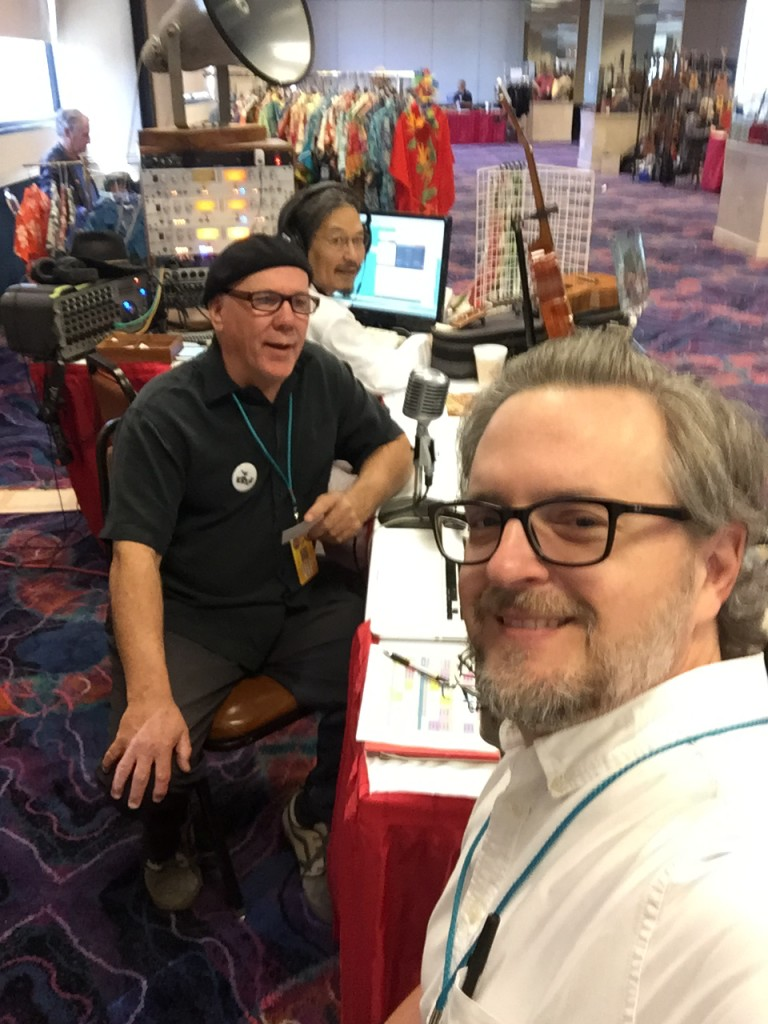 Uke player and teacher Jim D'Ville turned the tables on the magazine's new editor, Greg Olwell, for an interview on his radio show. That's Michael DaSilva manning the controls.
