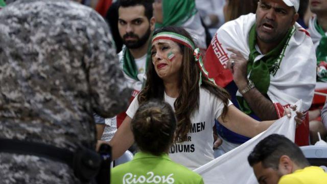 "Let Iranian Women Enter Their Stadiums."" (AP)"