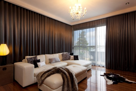Lavish living room with sheer and thick curtains
