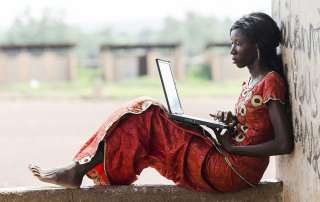 Photo: A woman uses a laptop computer.