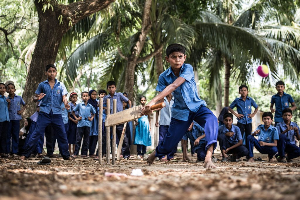 Photo: Rakib Hosain Sabbir, aged 9, a fourth grade student bats during a cricket game at Labsha Government Primary School in Satkhira Sadar, Bangladesh. Photo: UNICEF/Ashley Gilbertson VII