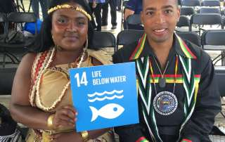 Photo: Chenae Bullock and Bryan Polite of the Shinnecock Nation in NY pose with Goal 14 at the Hokule'a event.