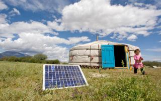 Photo: A family in Tarialan, Uvs Province, Mongolia, uses a solar panel to generate power for their ger, a traditional Mongolian tent. UN Photo/Eskinder Debebe.