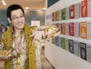 Piko Taro shows his 17 (Goals) sign in front of 'Spotlight on SDGs' photo exhibition on 17 July 2017 at United Nations Headquarters in New York. Photo: UN Photo/Mark Garten