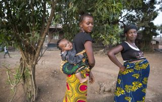 Two women and a baby in a village near the city of Makeni, in the northern province of Sierra Leone. UN Photo/Martine Perret