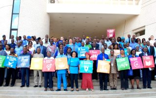 UN staff in Benin showing support for the SDGs. © UNDP Beni