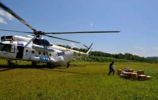 Boxes containing medication are unloaded from a helicopter. In hard to reach areas of Eastern Democratic Republic of the Congo, helicopters play a pivotal role in getting assistance to internally displaced persons and returnees. Photo: OCHA/Naomi Frerotte