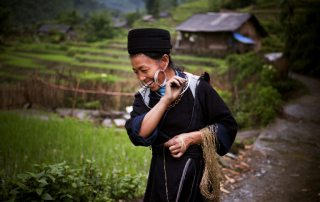A H/mong hill tribe woman in a village of Sin Chai, Sapa, Viet Nam. Women's labour accounts for the two-thirds of subsistence agriculture in developing countries, yet they often have no rights over the land. UN Photo/Kibae Park