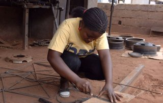 Piassa helps at her father's workshop, in Nampula, Mozambique after receiving entrepreneurship training under the UNIDO ECP Programme. Photo: UNIDO, 2011