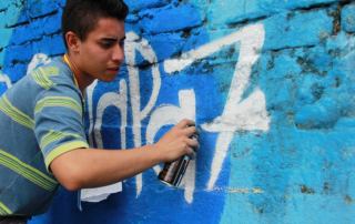 "A member of a neighbourhood collective focusing on youth inclusion in Ibagué, Colombia, takes part in the #RespiraPaz (""Breathe Peace"") campaign 