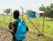 A 15-year-old boy, former child soldier on his way to school in a South Sudan town. (file) Photo: UNICEF/Ohanesian