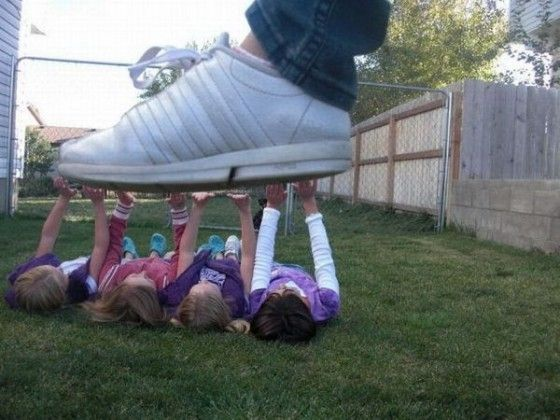 Perfectly timed photo of guy stepping on little girls
