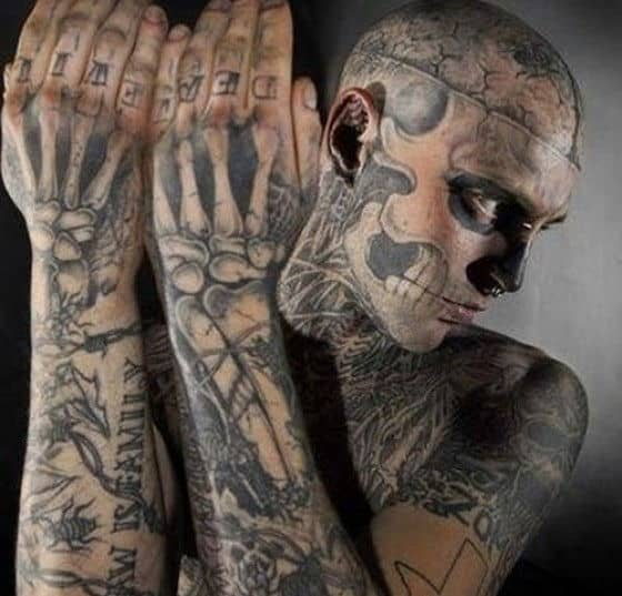 man tattooed to look like zombie