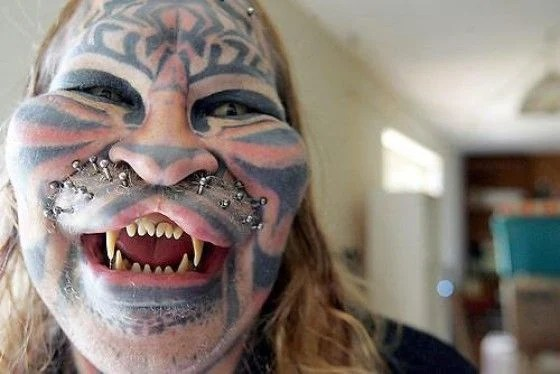 Man modified face to look like tiger