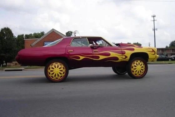 Chevy Caprice Donk Car with flames paintjob