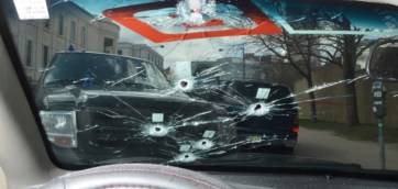 This photo provided by the Denver District Attorney's office shows bullet holes in the windshield of the car where Dion Ray Damon was shot by Technician Jeffery Motz on April 12, 2016. (Photo provided by Denver District Attorney's office)
