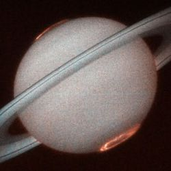 Saturn's aurora in Ultraviolet from Hubble.Credits: J.T. Trauger (Jet Propulsion Laboratory) and NASA.