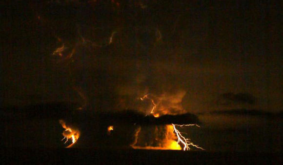 Photo of lightning from Redoubt Volcano during its 11:20 p.m. eruption on March 27, 2009.  Photo by Brentwood Higman.