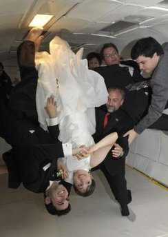 Noah Fulmor and Erin Finnegan flip in float as they say their 'I Do's' in weightlessness with ZERO-G. Credit: Reuters