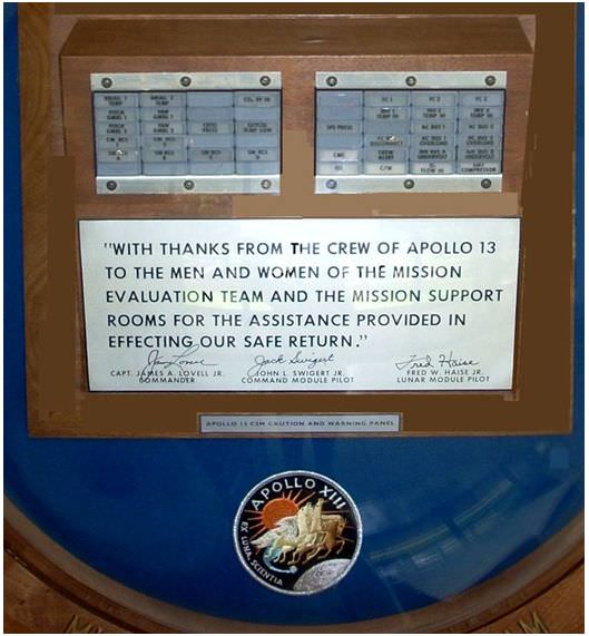 A plaque from the three Apollo 13 astronauts thanking the mission support teams.  Note the panels of the caution and warning system above the signatures.  Image Courtesy Jerry Woodfill.